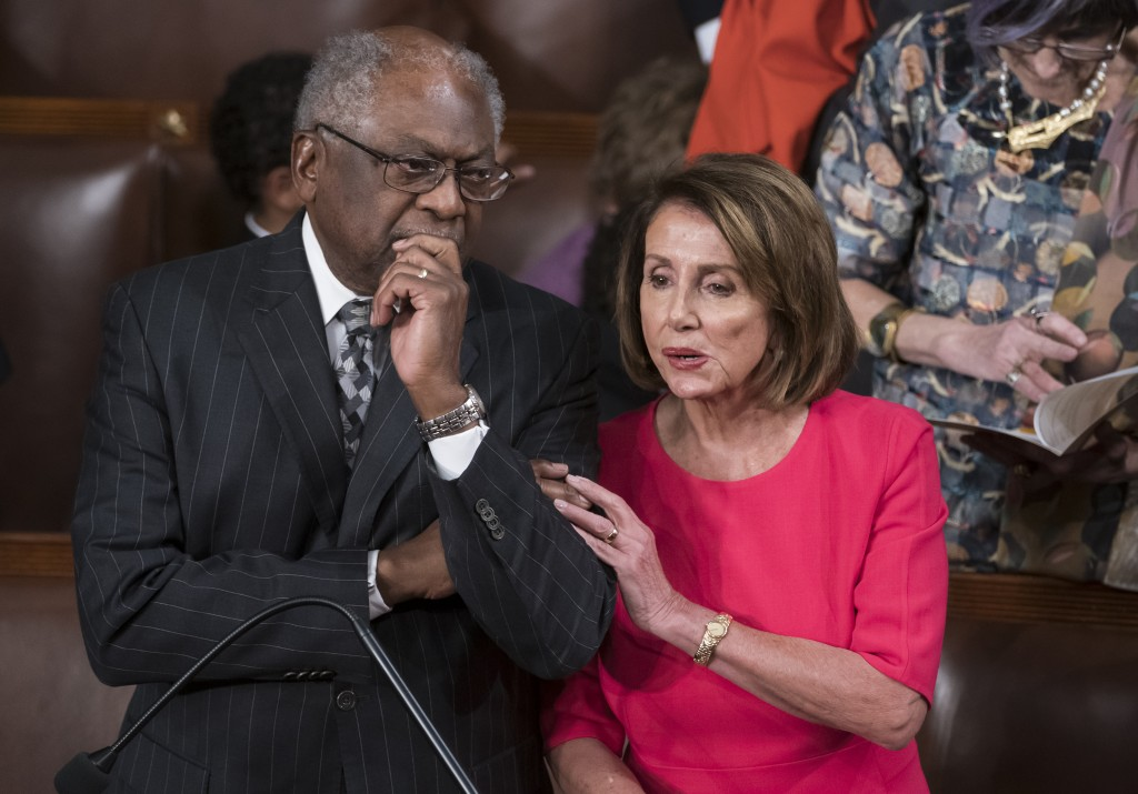 Speaker of the House Nancy Pelosi, D-Calif., talks with House Majority Whip James Clyburn, D-S.C., left, on the opening day of the 116th Congress as t...