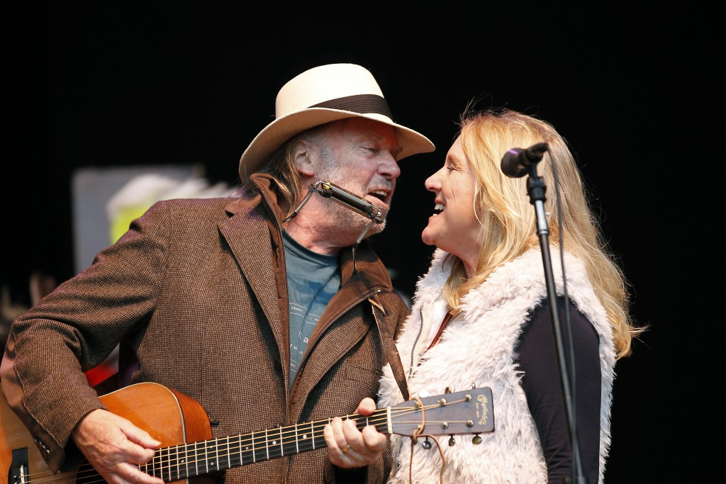 FILE - In this Oct. 24, 2010 file photo, Neil Young, left, and his wife Pegi Young perform during the Bridge School Benefit concert in Mountain View, ...