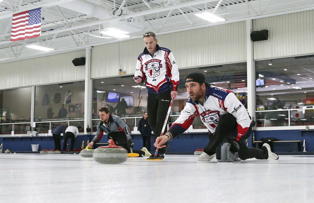 In this Jan. 3, 2019 photo, former Minnesota Vikings football player Jared Allen, right, practices with his curling team for a competition as coach an