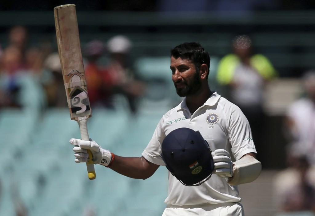 India's Cheteshwar Pujara celebrates making 150 runs against Australia on day 2 during their cricket test match in Sydney Friday Jan. 4 2019. (AP P