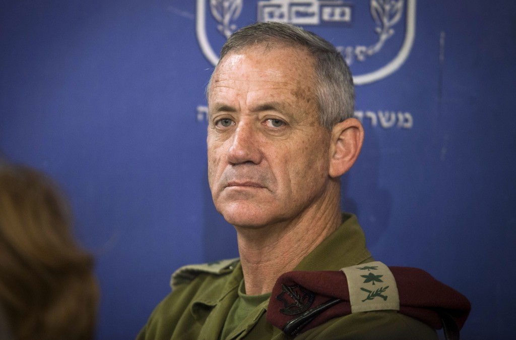 FILE - In this July 31, 2014 file photo, then Chief of General Staff of the Israel Defense Forces Lt. Gen. Benny Gantz attends a cabinet meeting at th