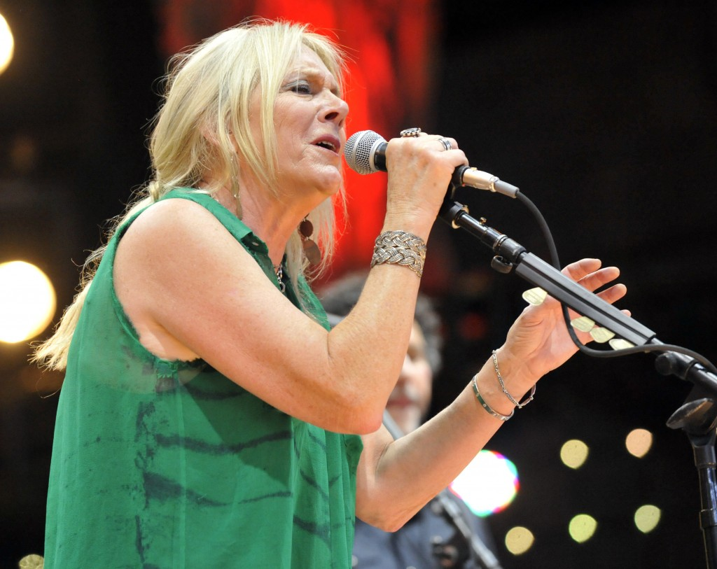 FILE - In this Sept. 21, 2013 file photo, Pegi Young & The Survivors perform with Neil Young during the Farm Aid 2013 concert at Saratoga Performing A...