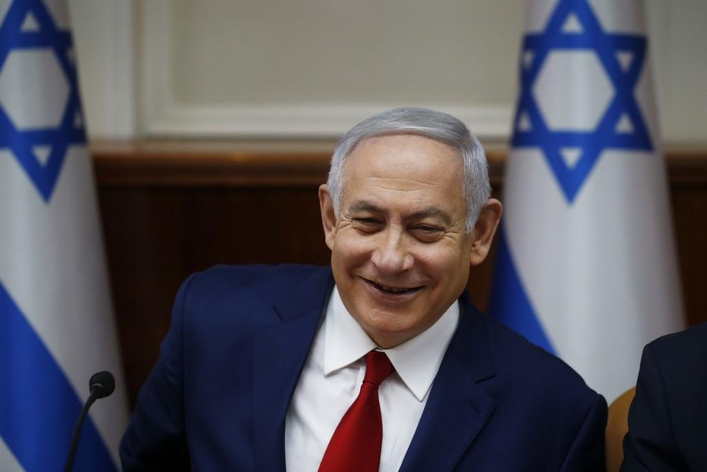 FILE - In this Dec. 23, 2018 file photo, Israeli Prime Minister Benjamin Netanyahu chairs the weekly cabinet meeting in Jerusalem. Barring a devastati