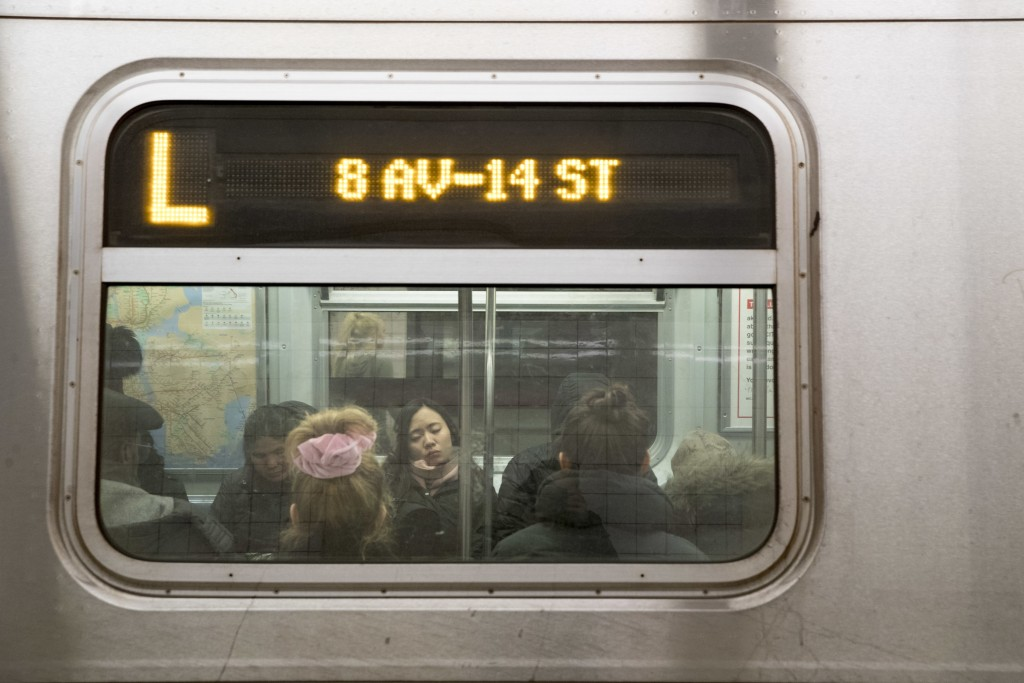 Commuters ride the L train, Thursday, Jan. 3, 2019, in New York. New York Gov. Andrew Cuomo said Thursday, he's calling off a planned 15-month shutdow