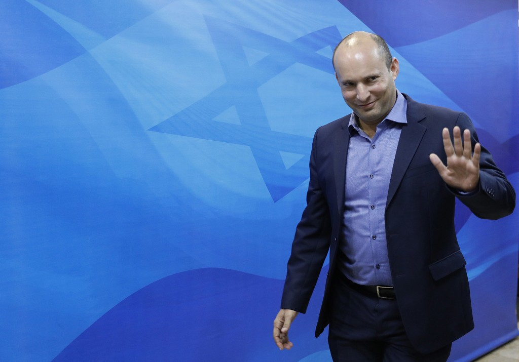 FILE - In this Nov. 18, 2018 file photo, Israeli Minister of Education Naftali Bennett arrives for the weekly cabinet meeting at the prime minister's