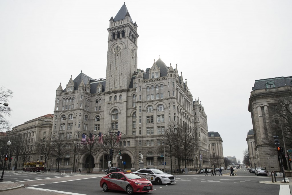 The Old Post Office Pavilion Clock Tower, which remains open during the partial government shutdown, is seen above the Trump International Hotel, Frid