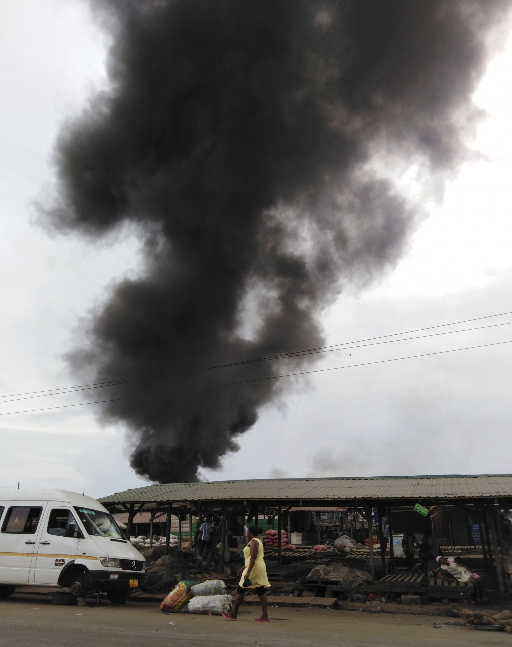 In this Nov. 26, 2018, photo, plumes of smoke rise above the Agbogbloshie dump site in Accra, Ghana. The billowing black smoke comes from the many inf...