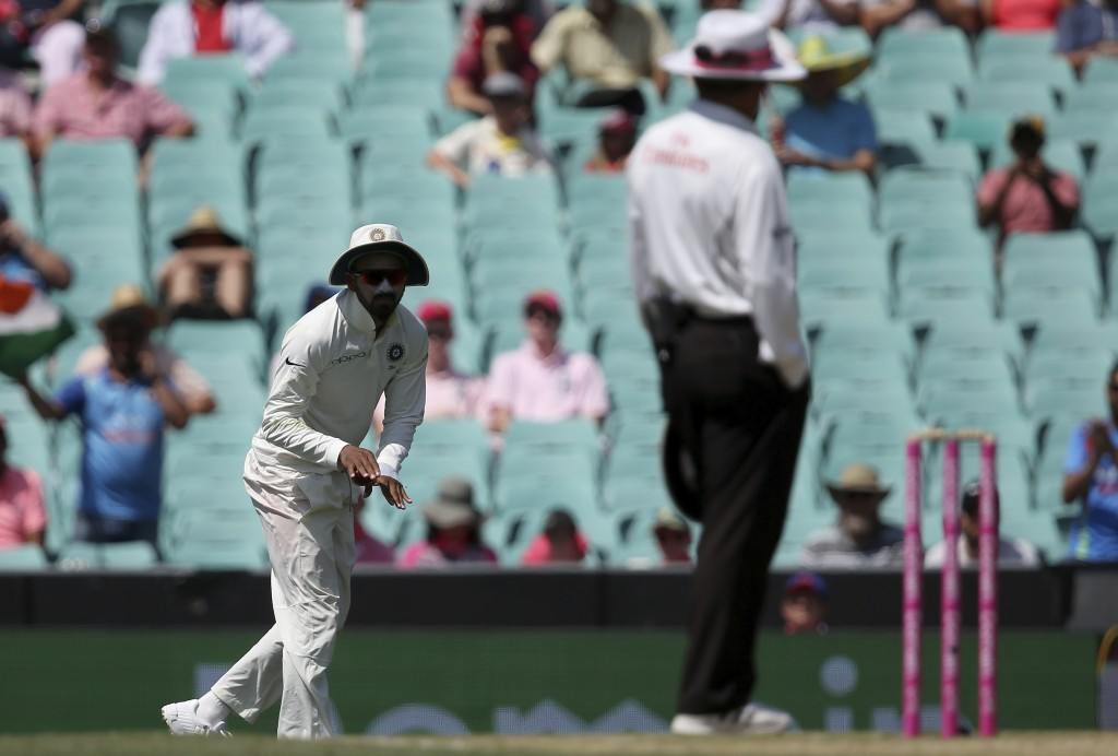 India's K.L. Rahul, left, signals to the umpire that he had not made a catch against Australia on day 3 of their cricket test match in Sydney, Saturda