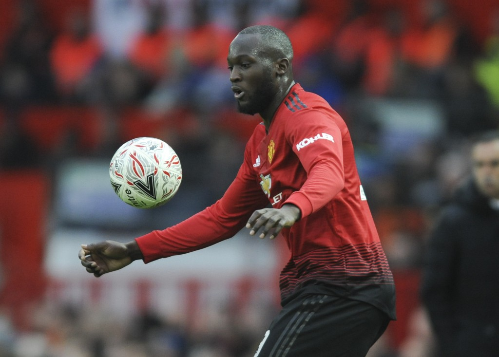 Manchester United's Romelu Lukaku challenge for the ball during the English FA Cup third round soccer match between Manchester United and Reading at O...