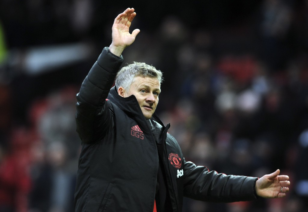 Manchester United manager Ole Gunnar Solskjær reacts after the English FA Cup third round soccer match between Manchester United and Reading at Old Tr...
