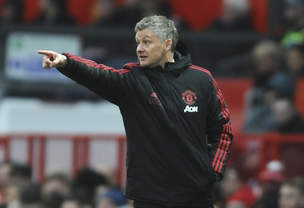 Manchester United manager Ole Gunnar Solskjær gives instructions during the English FA Cup third round soccer match between Manchester United and Read