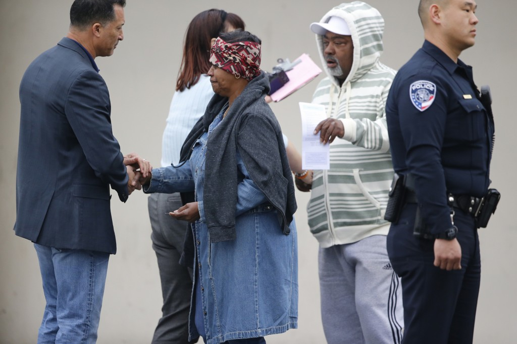 Torrance Police Department investigators express their condolences to unidentified family members, as officers confirm fatalities after a shooting inc...