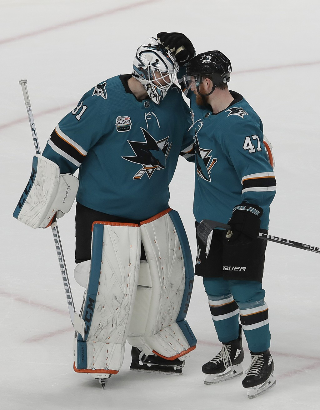 San Jose Sharks goalie Martin Jones (31) celebrates with defenseman Joakim Ryan (47) after the Sharks beat the Tampa Bay Lightning in an NHL hockey ga