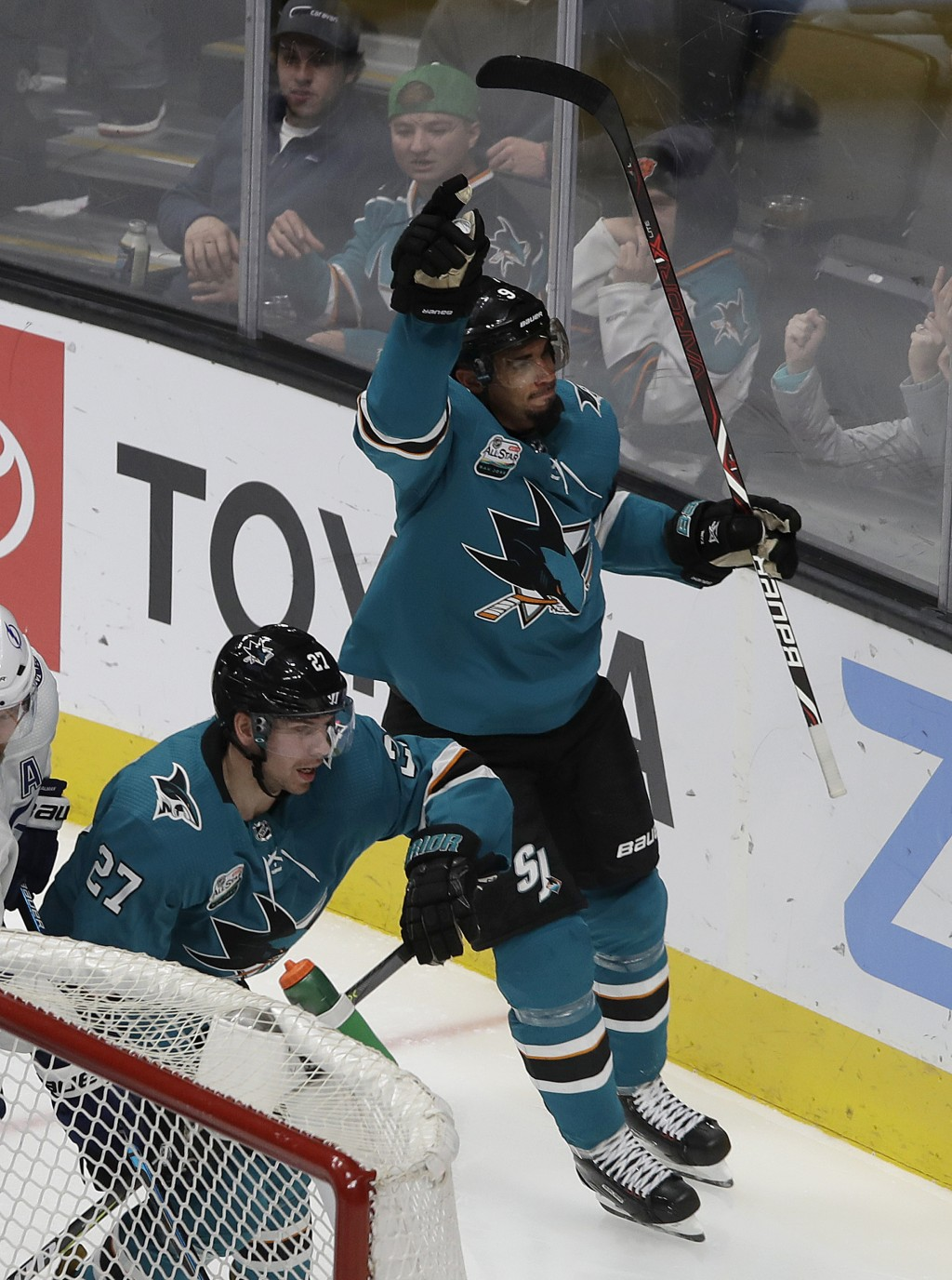 San Jose Sharks left wing Evander Kane celebrates after scoring a goal against the Tampa Bay Lightning during the third period of an NHL hockey game i