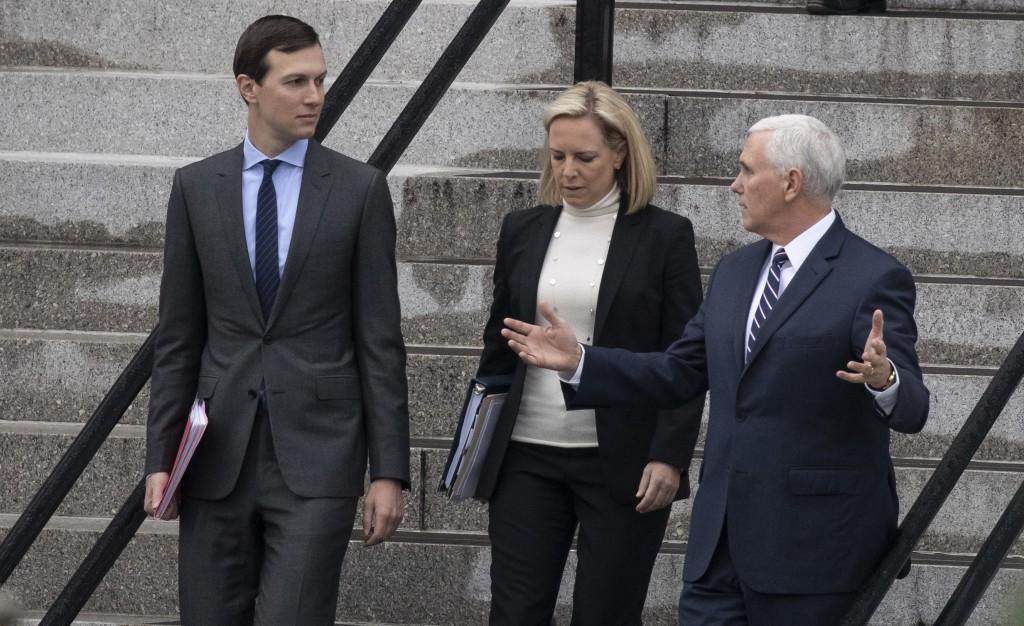White House Senior Adviser Jared Kushner, left, Homeland Security Secretary Kirstjen Nielsen, and Vice President Mike Pence, talk as they walk down th...