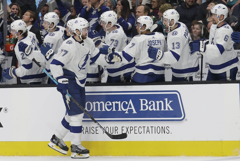 Tampa Bay Lightning defenseman Victor Hedman (77), from Sweden, is congratulated by teammates after scoring against the San Jose Sharks during the fir