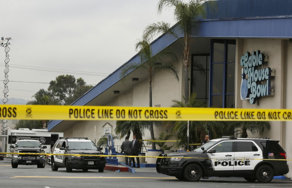 Police officers investigate a shooting incident with multiple fatalities at the Gable House Bowl in Torrance, Calif., Saturday, Jan. 5, 2019. A brawl ...