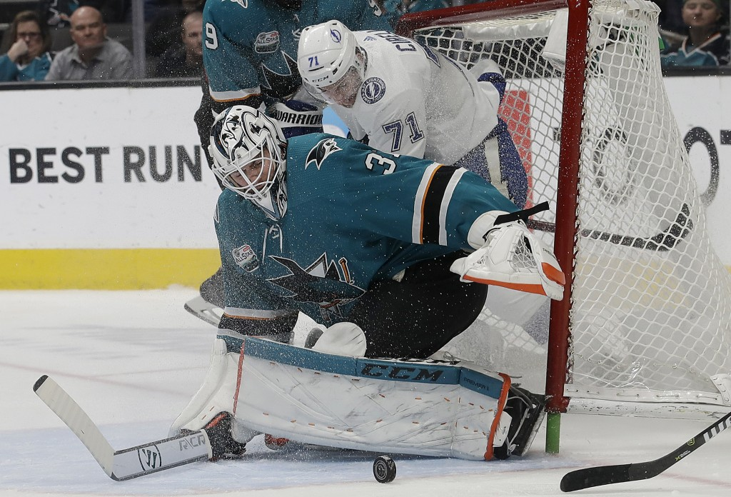 San Jose Sharks goalie Martin Jones (31) defends the net in front of Tampa Bay Lightning center Anthony Cirelli (71) during the second period of an NH
