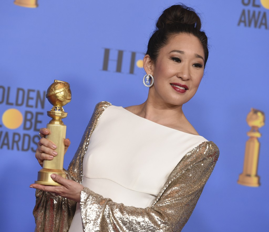 """Sandra Oh poses in the press room with the award for best performance by an actress in a television series, drama for """"Killing Eve"""" at the 76th annual"""