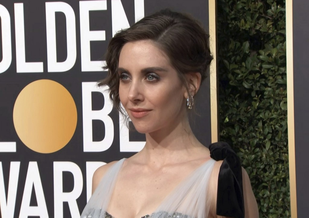This image taken from video shows actress Alison Brie arriving at the 76th annual Golden Globe Awards at the Beverly Hilton Hotel on Sunday, Jan. 6, 2
