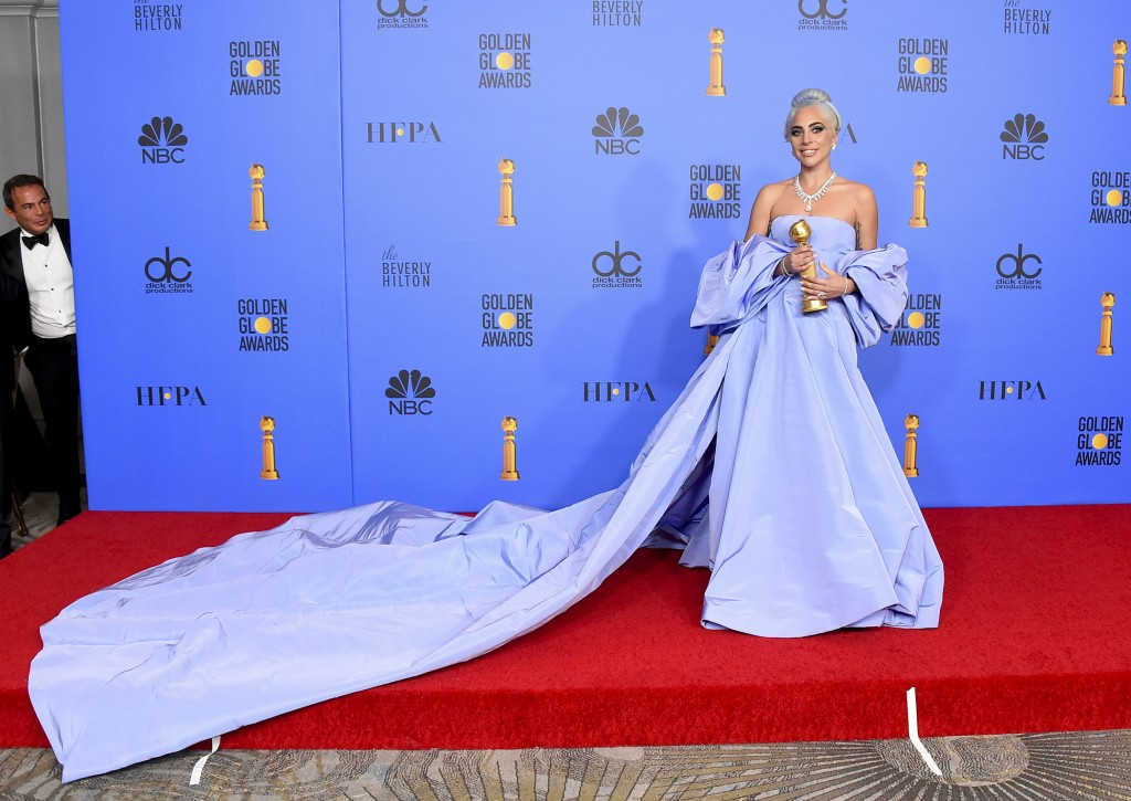 """Lady Gaga poses in the press room with the award for best original song, motion picture for """"Shallow"""" from the film """"A Star Is Born"""" at the 76th annua"""