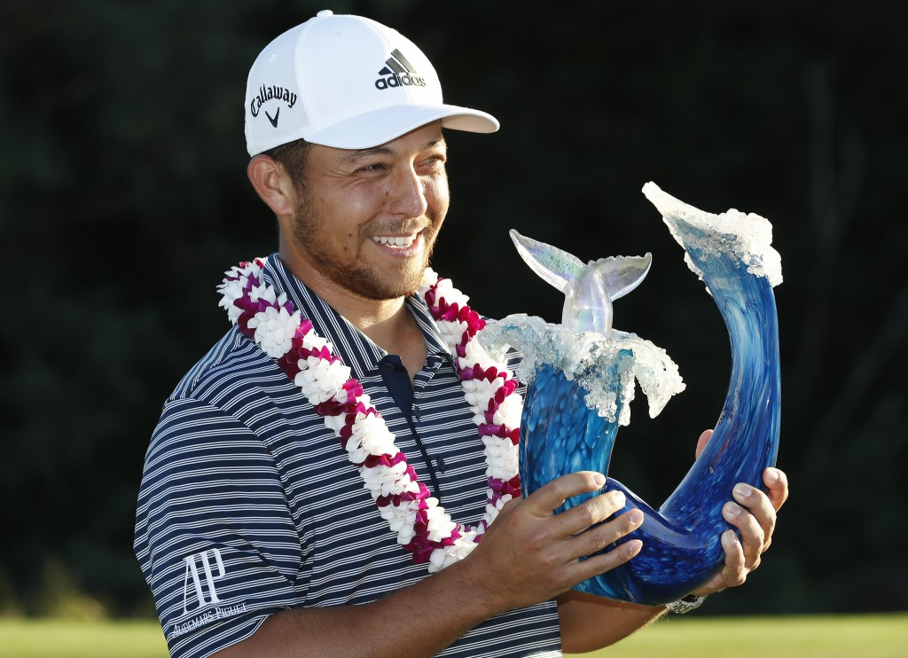 Xander Schauffele holds the champions trophy after the final round of the Tournament of Champions golf event, Sunday, Jan. 6, 2019, at Kapalua Plantat