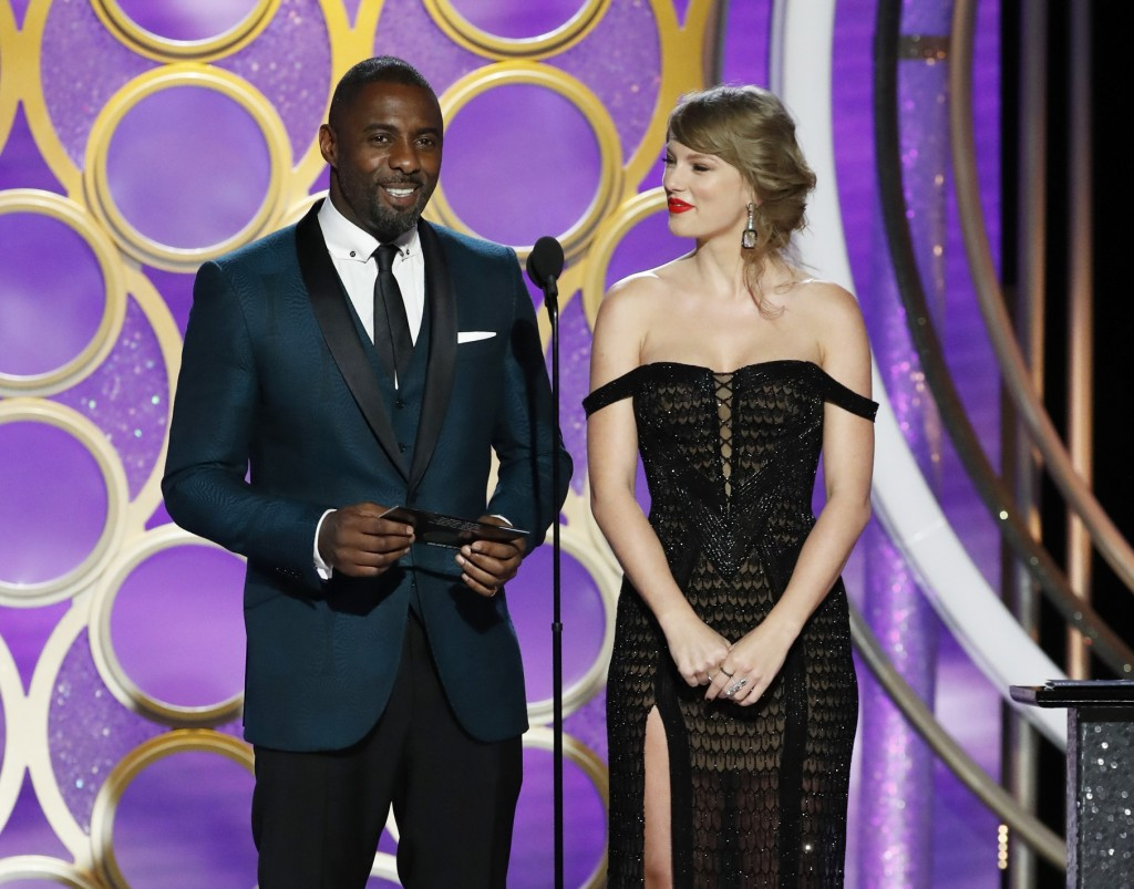 This image released by NBC shows presenters Idris Elba and Taylor Swift during the 76th Annual Golden Globe Awards at the Beverly Hilton Hotel on Sund