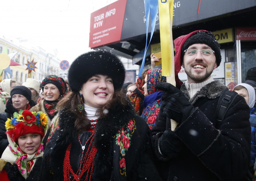 People react after the service marking Orthodox Christmas and celebrating the independence of the Ukrainian Orthodox Church out of the St. Sophia Cath...