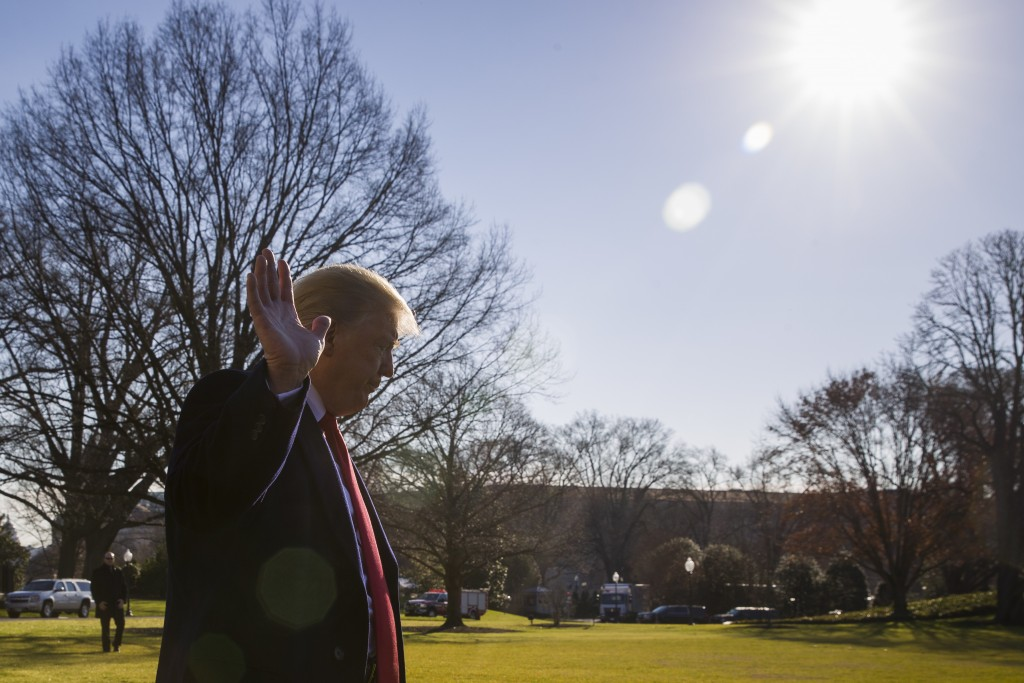 President Donald Trump waves as he departs after speaking on the South Lawn of the White House as he walks to Marine One, Sunday, Jan. 6, 2019, in Was