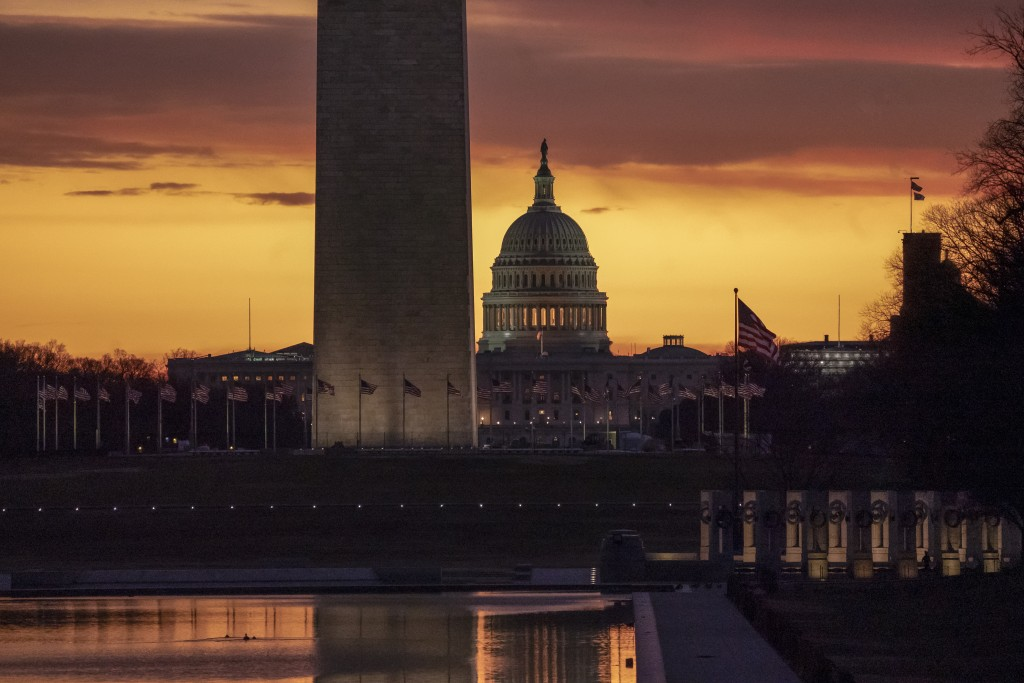 The Capitol and Washington Monument are seen at dawn as the partial government shutdown lurches into a third week with President Donald Trump standing...