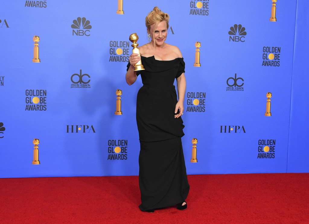 Patricia Arquette poses in the press room with the award for best performance by an actress in a limited series or a motion picture made for televisio
