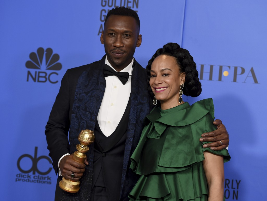 "Mahershala Ali, left, winner of the award for best performance by an actor in a supporting role in any motion picture for ""Green Book,"" and Amatus Sam"