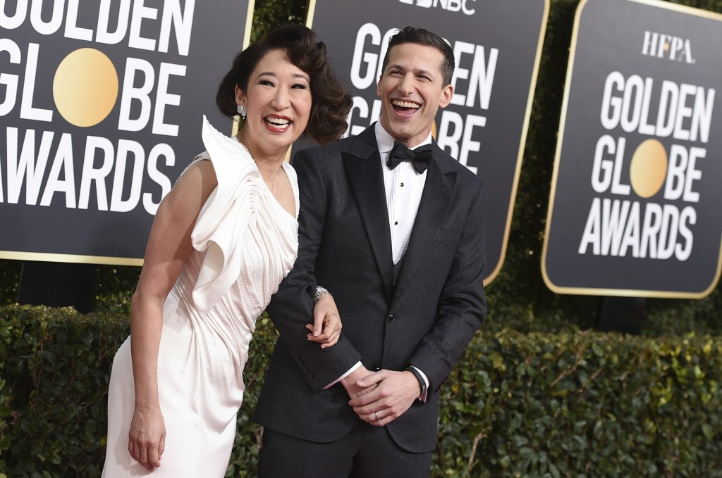 Hosts Sandra Oh, left, and Andy Samberg arrive at the 76th annual Golden Globe Awards at the Beverly Hilton Hotel on Sunday, Jan. 6, 2019, in Beverly