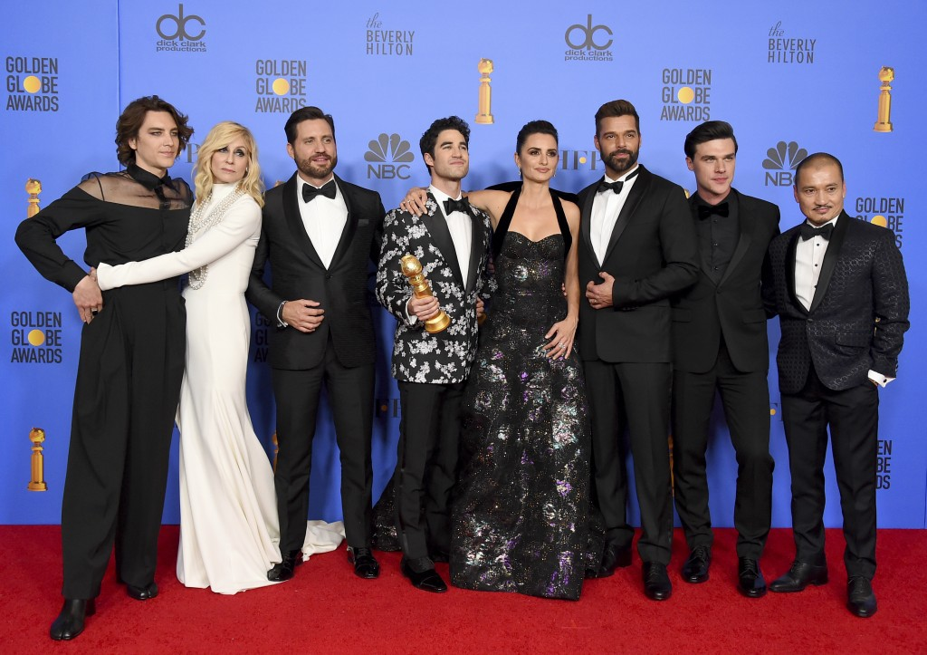 """The cast of """"The Assassination of Gianni Versace: American Crime Story"""" poses in the press room with the award for best television limited series or m"""