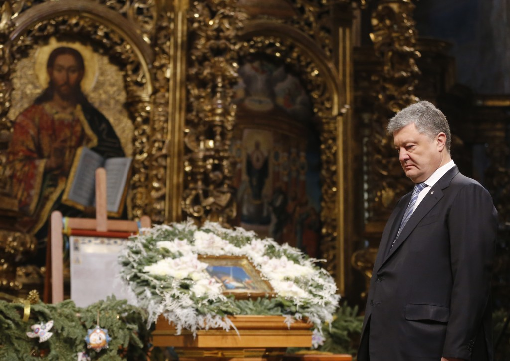 Ukrainian President Petro Poroshenko attends the service marking Orthodox Christmas and celebrating independence of Ukrainian Orthodox Church in the S...