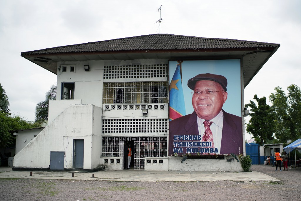 A giant portrait of UDPS presidential candidate Felix Tshisekedi is set on his party headquarters in Kinshasa, Congo, Tuesday Jan. 8, 2019, to partici...