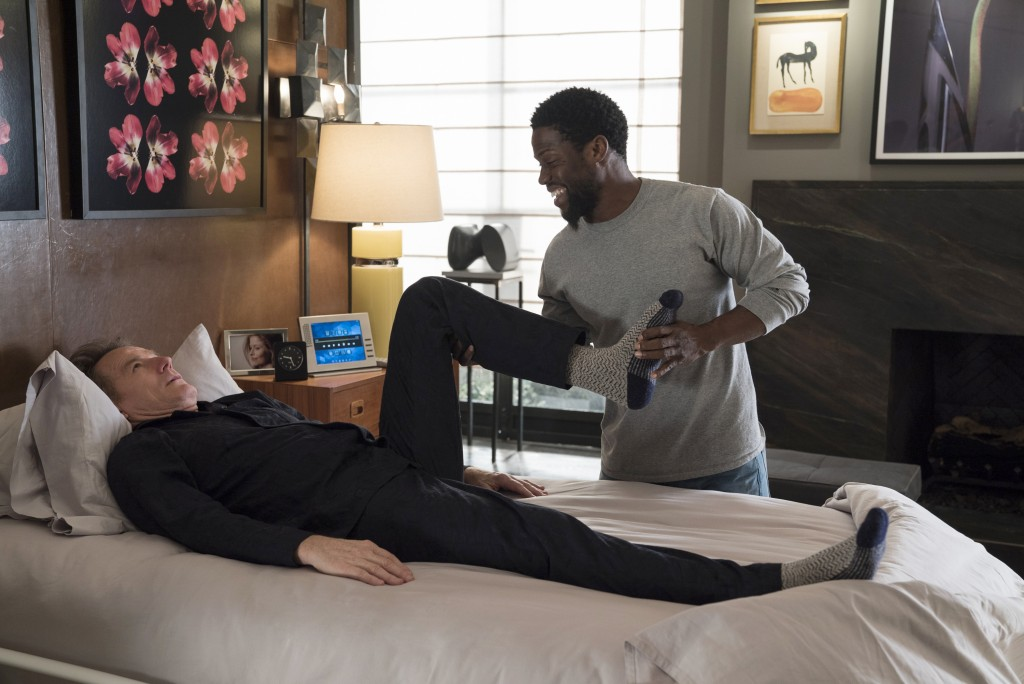 """This image released by STXfilms shows Bryan Cranston, left, and Kevin Hart in a scene from """"The Upside."""" (David Lee/STXfilms via AP)"""