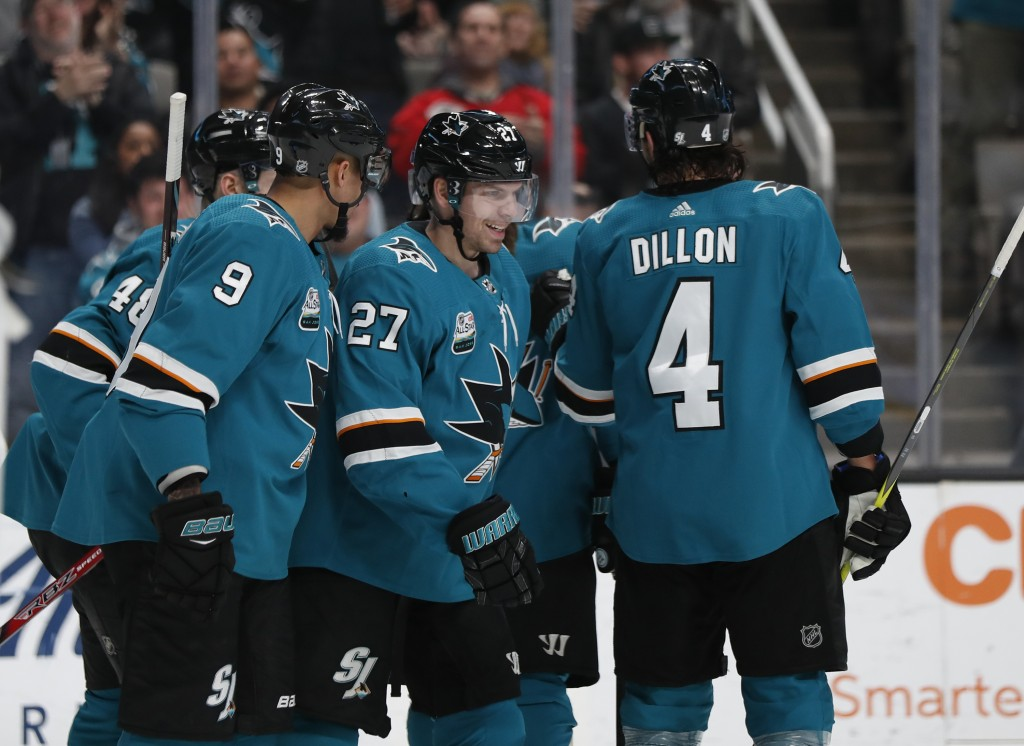 San Jose Sharks' Evander Kane (9) celebrates with Joonas Donskoi (27) who scored goal against the Los Angeles Kings in the first period of an NHL hock