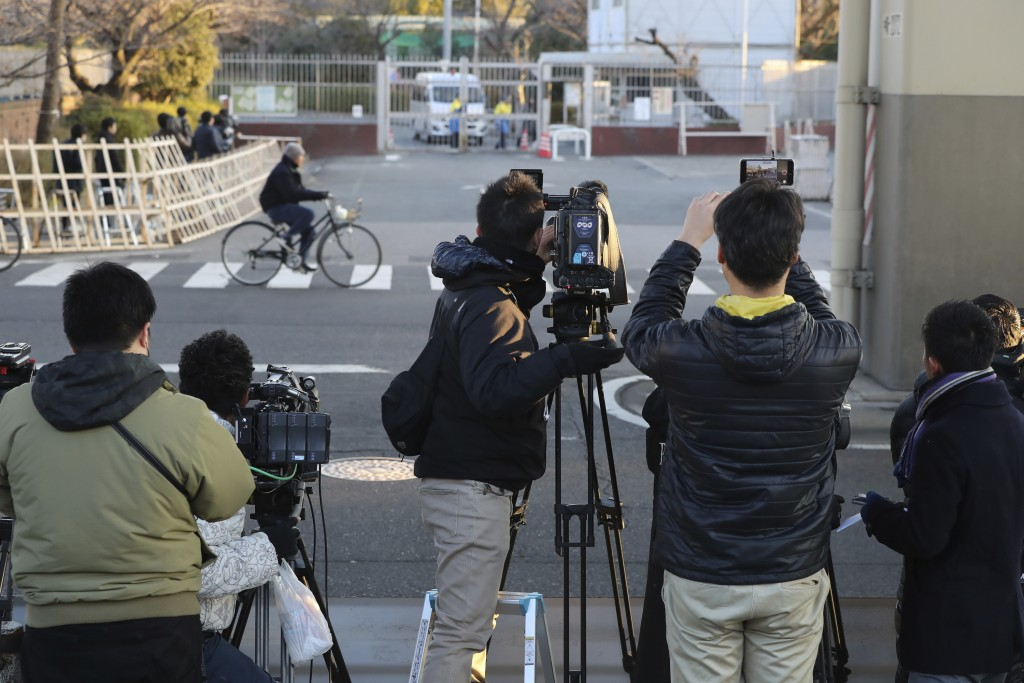 TV crews prepare in front of Tokyo Detention Center, where former Nissan chairman Carlos Ghosn is detained, in Tokyo on Tuesday, Jan. 8, 2019. Ghosn i...