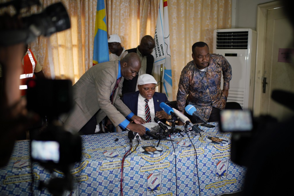UDPS general secretary Jean-Marc Kabund holds a press briefing at party headquarters in Kinshasa, Congo, Tuesday Jan. 8, 2019, to participate in a gen