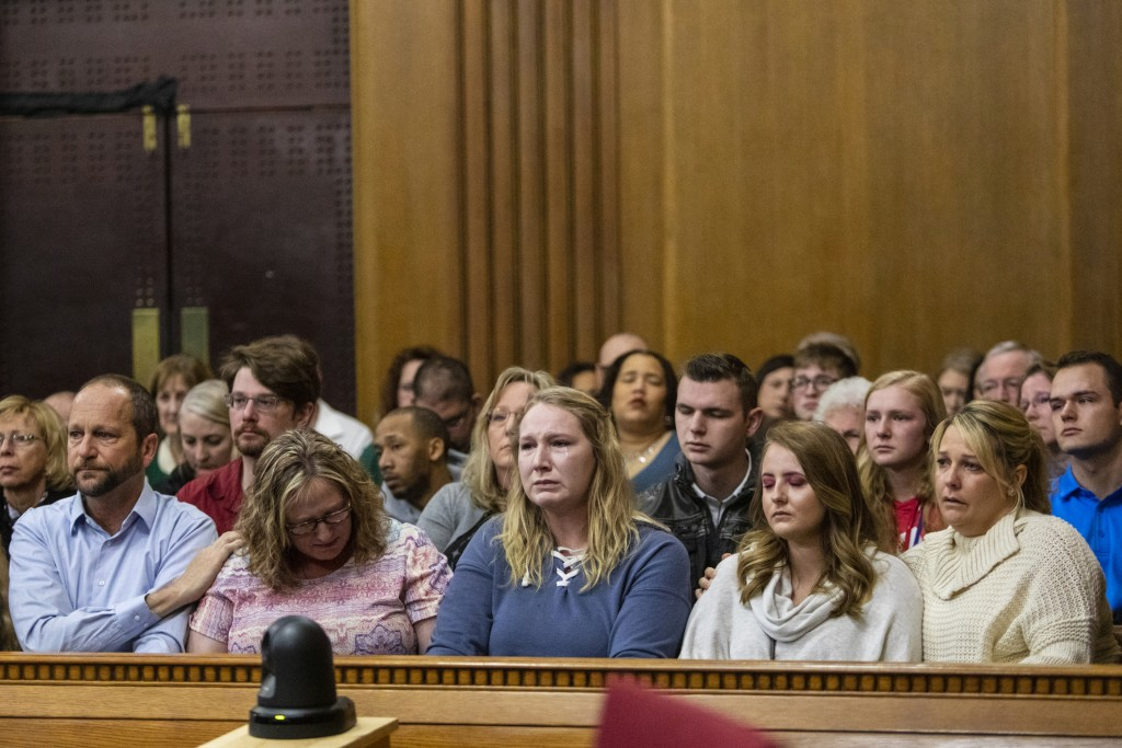 Victim family members react as Jason Dalton pleads guilty to six counts of murder and several other charges at the Kalamazoo County Courthouse on Mond...