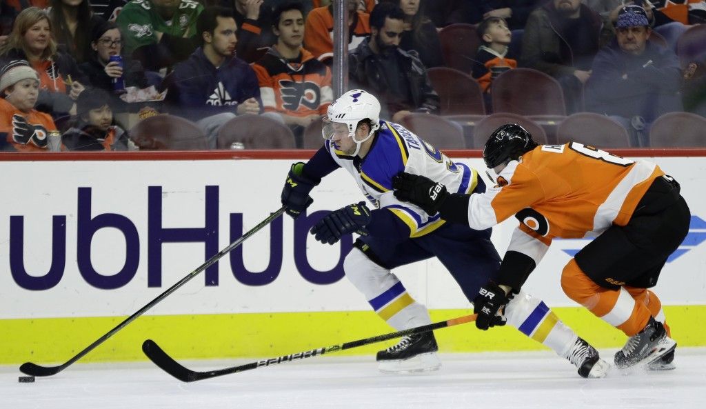 St. Louis Blues' Vladimir Tarasenko, left, tries to slips past Philadelphia Flyers' Robert Hagg during the first period of an NHL hockey game, Monday,...
