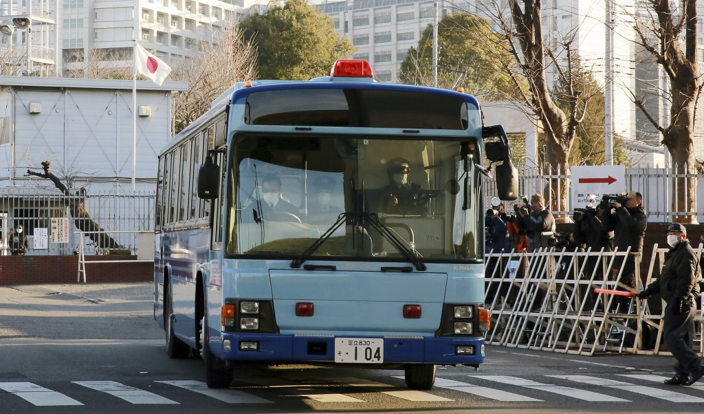 In this Tuesday, Jan. 8, 2019, file photo, a vehicle presumably carrying former Nissan chairman Carlos Ghosn leaves Tokyo Detention Center in Tokyo. G...