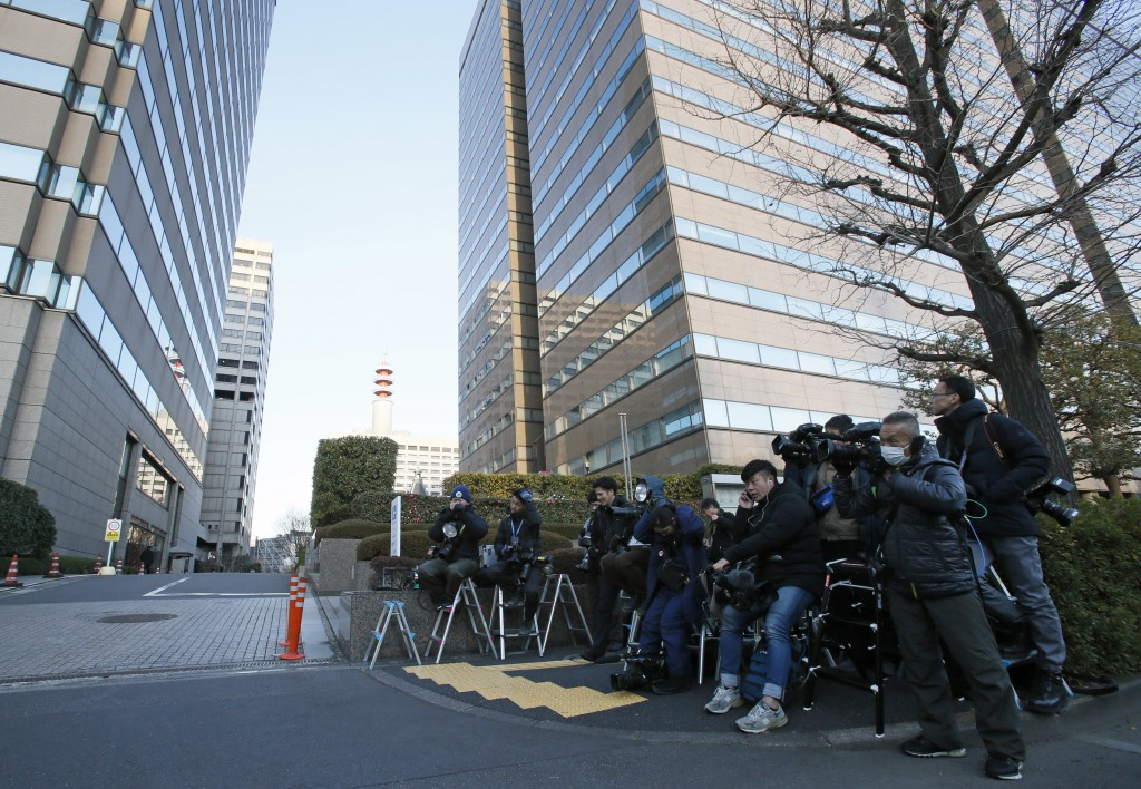 Reporters and cameramen wait outside Tokyo District Court in Tokyo Tuesday, Jan. 8, 2019. Former Nissan chairman Carlos Ghosn is scheduled to face a T...