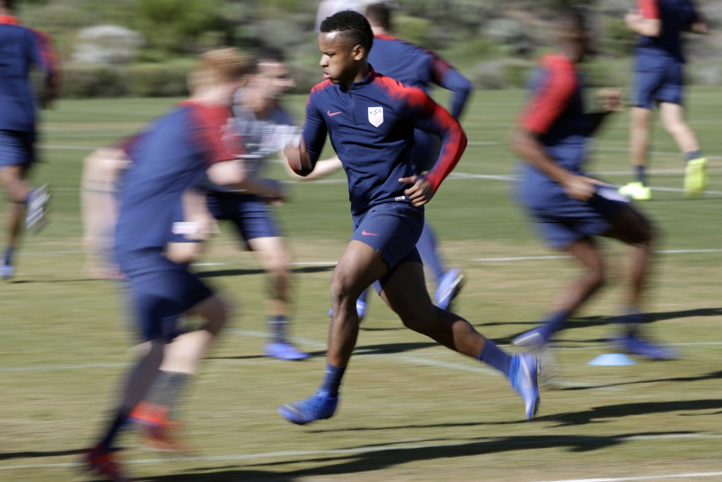 United States players warm up during soccer training camp Monday, Jan. 7, 2019, in Chula Vista, Calif. (AP Photo/Marcio Jose Sanchez)