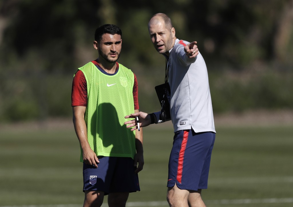 United States head coach Gregg Berhalter, right, instructs player Cristian Roldan during a soccer training camp Monday, Jan. 7, 2019, in Chula Vista,
