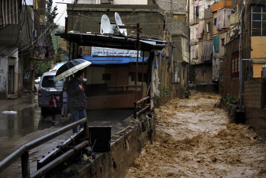 Rushing rainwater fills a canal in Beirut, Lebanon, Tuesday, Jan. 8, 2019. A strong storm and heavy rainfall turned streets in Lebanon into rivers of