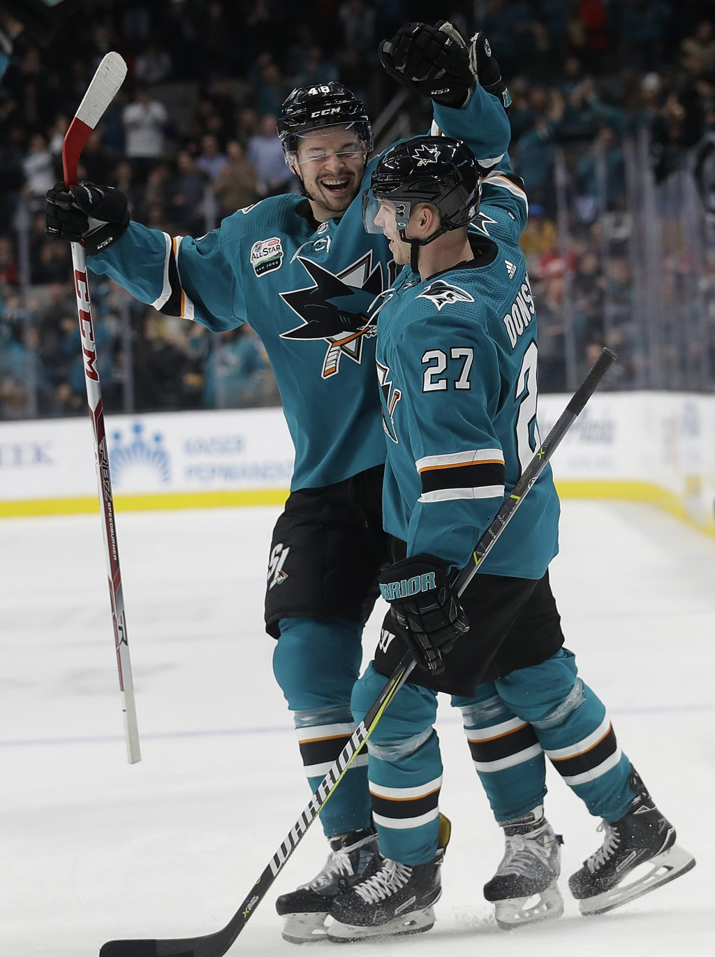 San Jose Sharks right wing Joonas Donskoi (27), from Finland, is congratulated by Tomas Hertl, from the Czech Republic, after scoring against the Edmo