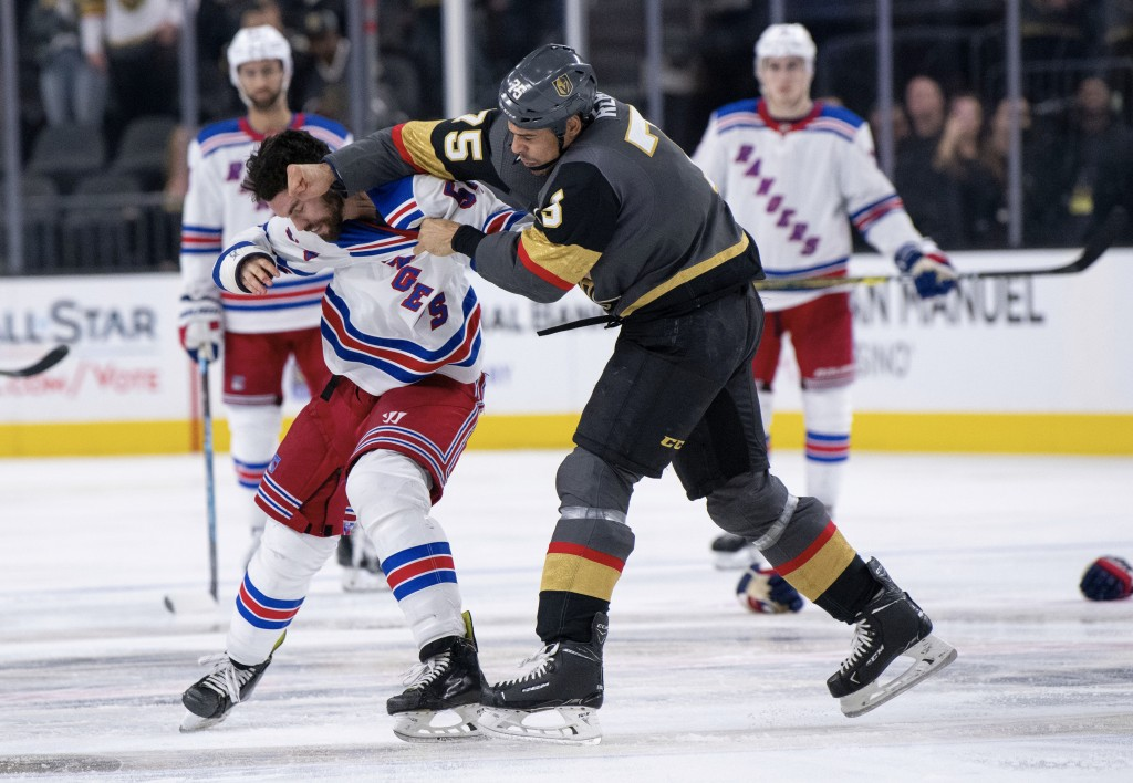 Vegas Golden Knights right wing Ryan Reaves and New York Rangers defenseman Adam McQuaid fight during the third period of an NHL hockey game Tuesday,
