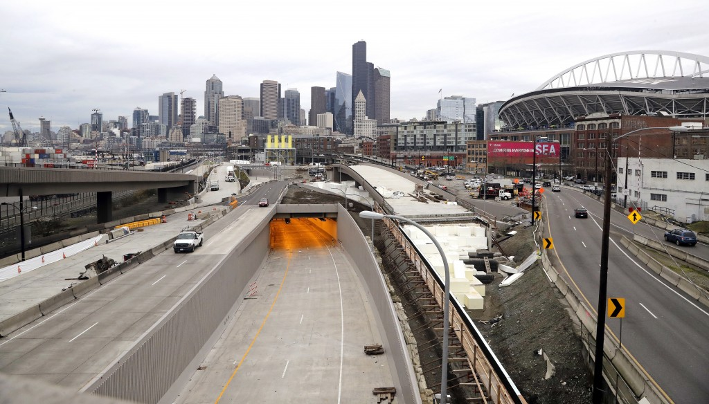 In this photo taken Wednesday, Jan. 2, 2019, amber light spills out of the tunnel that will shortly become the new Highway 99, as traffic moves along